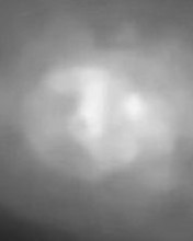 non-color cranium with face within space light